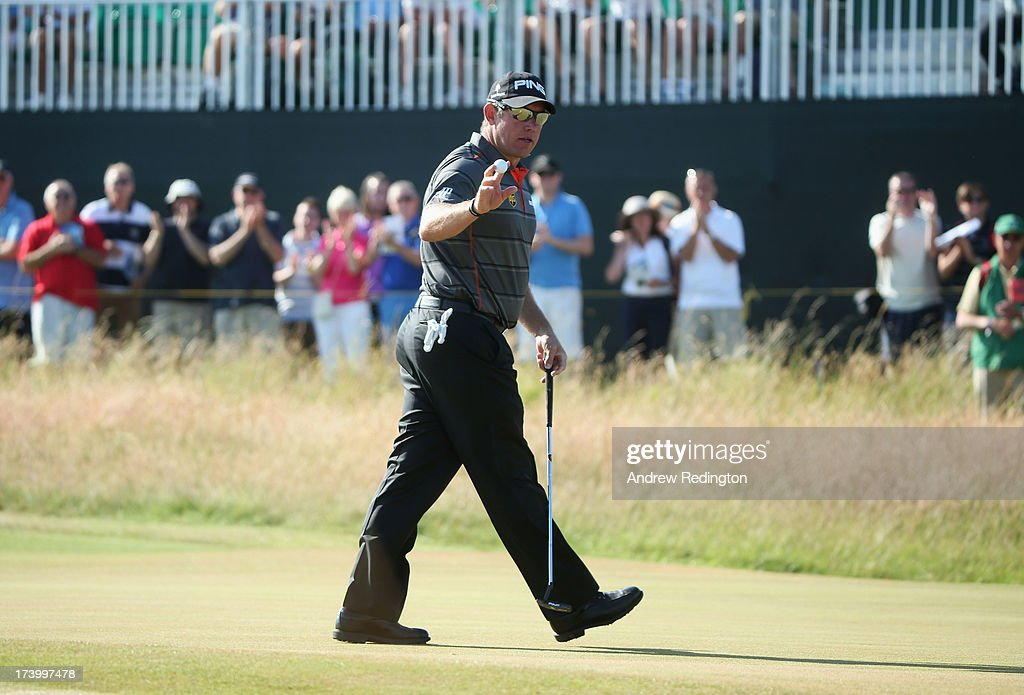 Lee Westwood of England waves on the 1st green during the second round of the 142nd Open Championship at Muirfield on July 19, 2013 in Gullane, Scotland.