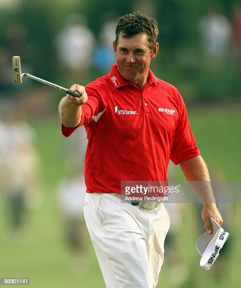 Lee Westwood of England waves to the crowd on the 18th hole on his way to victory in the Dubai World Championship and the Race To Dubai on the Earth...