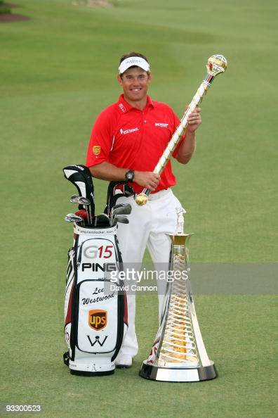 Lee Westwood of England with the Dubai World Championship and the Race to Dubai trophies after his victory in the final round of the Dubai World...