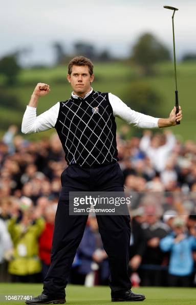 Lee Westwood of Europe celebrates holing a putt on the 10th green during the Fourball Foursome Matches during the 2010 Ryder Cup at the Celtic Manor...