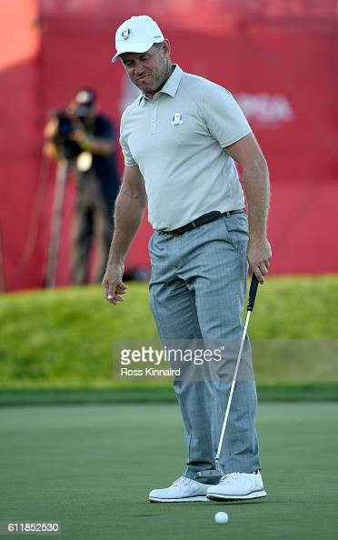 Lee Westwood of Europe reacts after missing a putt on the 18th green during afternoon fourball matches of the 2016 Ryder Cup at Hazeltine National...
