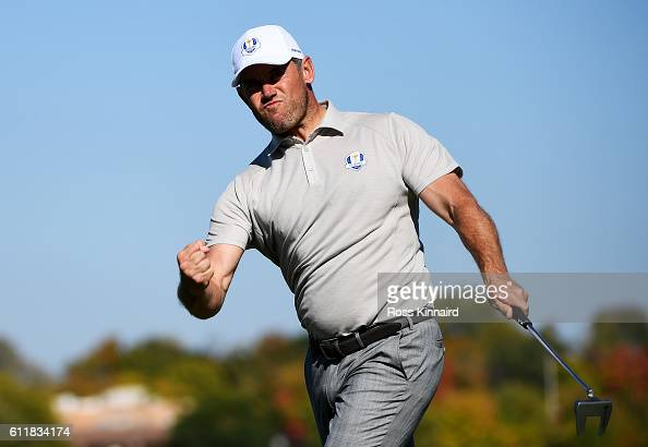 Lee Westwood of Europe reacts to a birdie putt on the seventh green during afternoon fourball matches of the 2016 Ryder Cup at Hazeltine National...