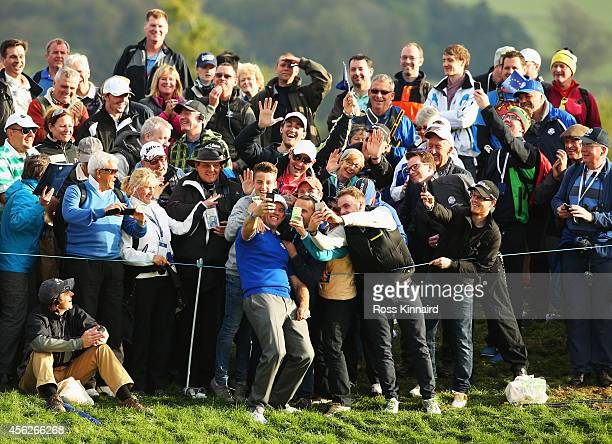 Lee Westwood of Europe takes a selfie with spectators in the crowd on the 16th hole after Europe won the Ryder Cup during the Singles Matches of the...