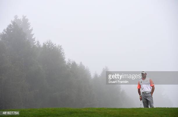 Lee Westwool of England waits in the fog during the first round of the Omega European Masters at CranssurSierre Golf Club on July 23 2015 in...