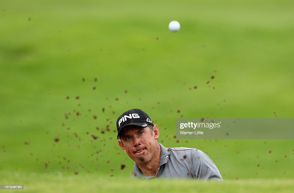 Lee Weswood of England plays out of the 10th greenside bunker during the final round of the Nedbank Golf Challenge at the Gary Player Country Club on December 2, 2012 in Sun City, South Africa.
