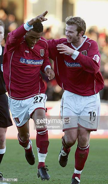 Lee Williamson of Northampton celebrates his goal with team mate Martin Smith during the FA Cup Third Round match between Northampton Town and...