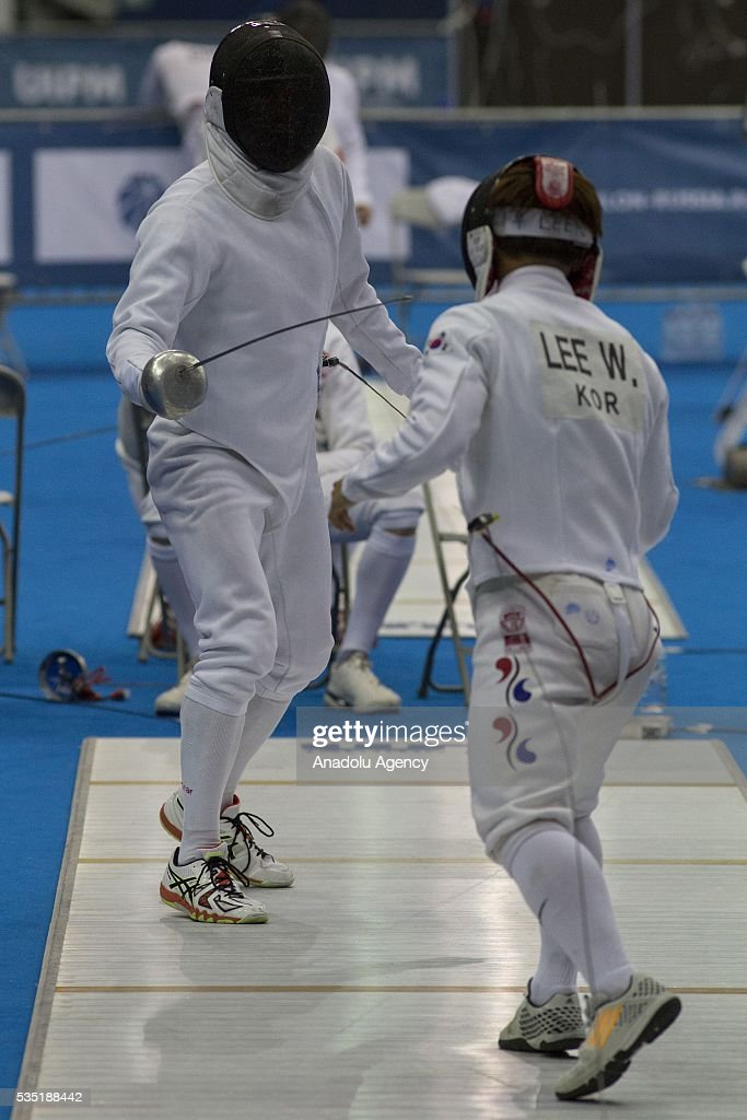 Lee Woo Jin (R) from Korea competes in the fencing at the mixed relay World Championship in modern pentathlon in Olympic Sports Complex in Moscow, Russia, on May 29, 2016.