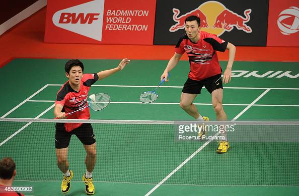 Lee Yong Dae and Yoo Yeon Seong of Korea compete against Andries Malan and Willem Viljoen of South Africa in the 2015 Total BWF World Championship at...