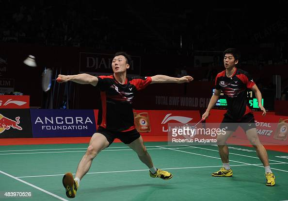 Lee Yong Dae and Yoo Yeon Seong of Korea compete against Fu Haifeng and Zhang Nan of China in the quarter final match of the 2015 Total BWF World...