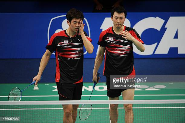 Lee Yong Dae and Yoo Yeon Seong of Korea react after defeated by Ko Sung Hyun and Shin Baek Choel of Korea during the 2015 BCA Indonesia Open...