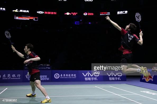 Lee Yong Dae and Yoo Yeon Seong of Korea return to Hirokatsu Hashimoto and Noriyasu Hirata of Japan during Men's Doubles match in the semifinals on...