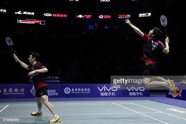 Lee Yong Dae and Yoo Yeon Seong of Korea return to Hirokatsu Hashimoto and Noriyasu Hirata of Japan during Men's Doubles match in the semifinals on...