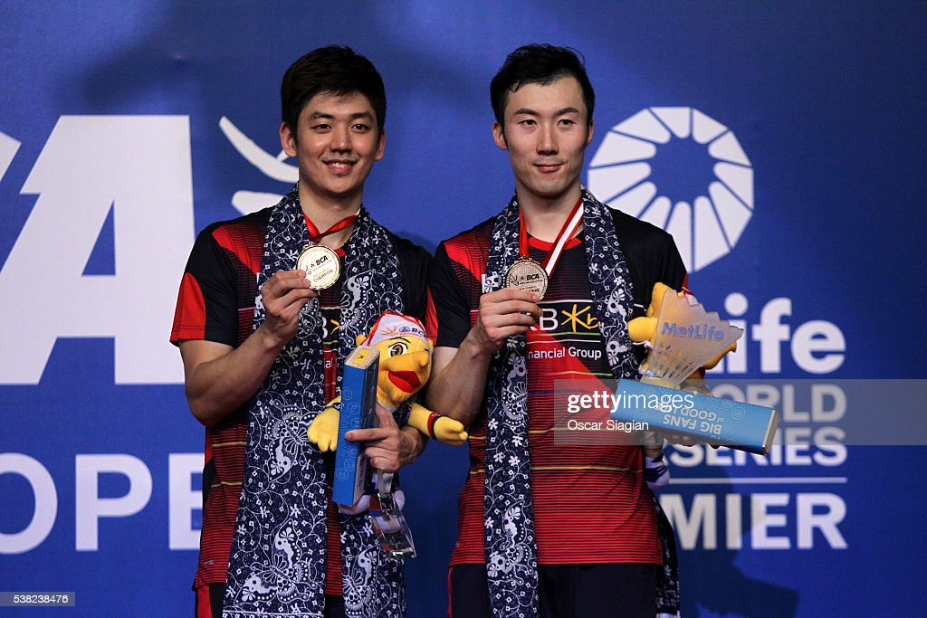 Lee Yong Dae and Yoo Yeon Seong of South Korea pose on the podium after win the 2016 Indonesia in Man's double final match against Chai Biao and Hong Wei of China on June 5, 2016 in Jakarta, Indonesia.