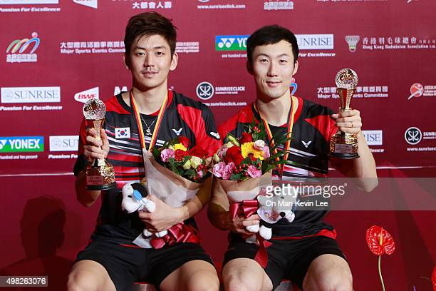 Lee Yong Dae and Yoo YeonSeong pose for a picture with their medals after the match between Yoo Yeon Seong and Lee Yong Dae of Korea and Mathias Boe...