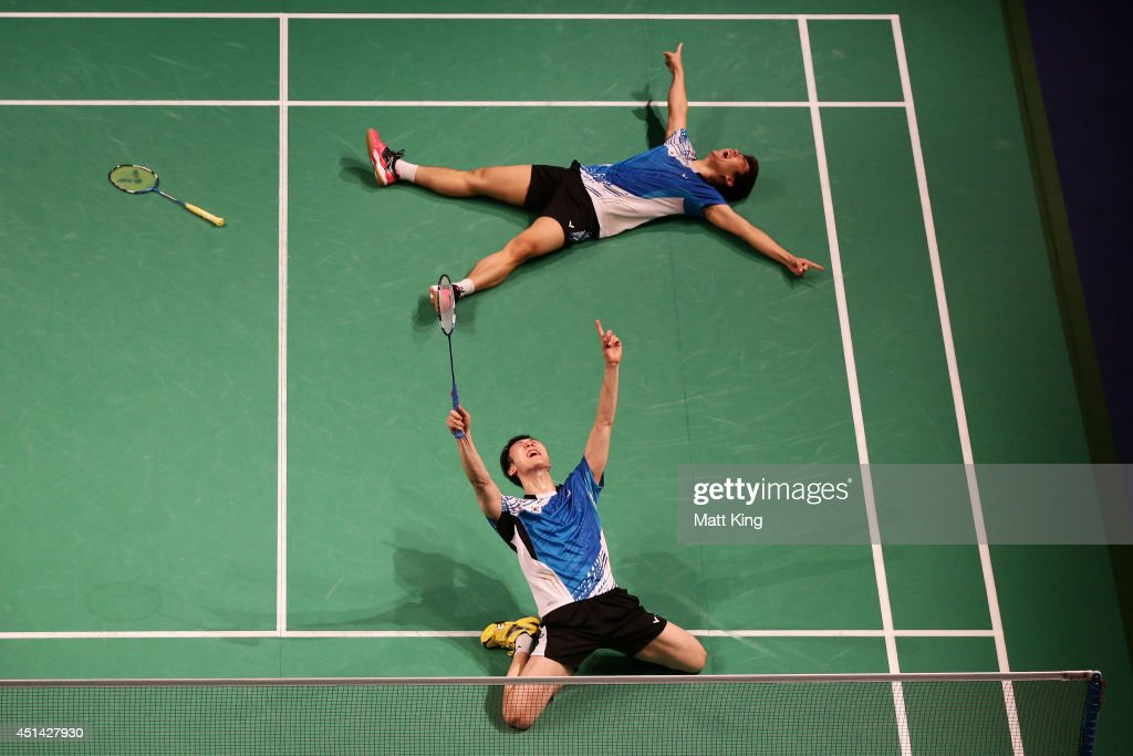 Lee Yong Dae Lee (bottom) and Yeon Seong Yoo (top) of Korea celebrate winning the Mens Doubles Final against Lee Sheng-mu and Tsai Chia-Hsin of Chinese Taipei during the Australian Badminton Open at Sydney Olympic Park Sports Centre on June 29, 2014 in Sydney, Australia.