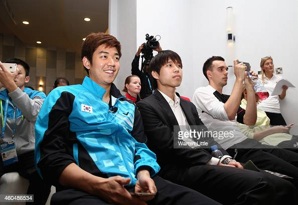 Lee Yong Dae of Korea and Chris Adcock of England watch the draw ceremony and press conference for the BWF Destination Dubai World Superseries Finals...