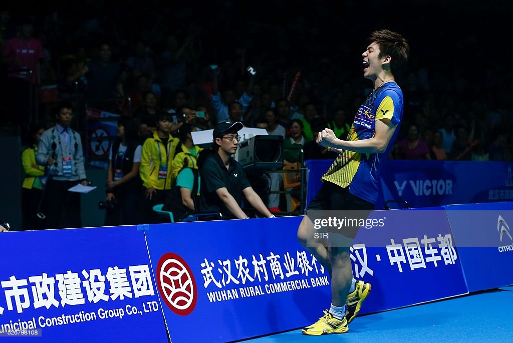 Lee Yong Dae of South Korea celebrates after winning the men's doubles final match against Li Junhui and Liu Yuchen of China at the 2016 Badminton Asia Championships in Wuhan, central China's Hubei province on May 1, 2016. / AFP / STR
