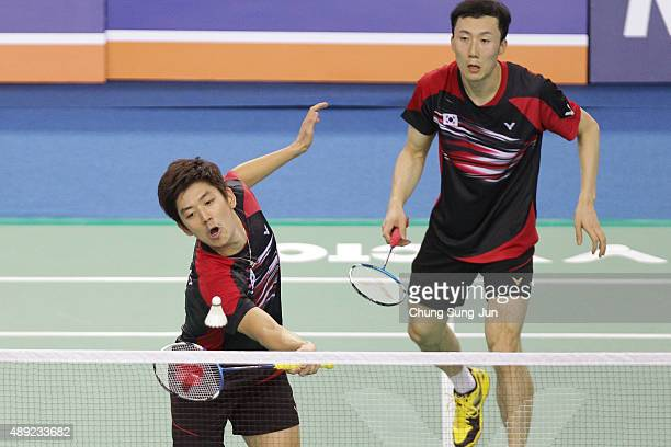 Lee YongDae and Yoo YeonSeong of South Korea compete against Kim GiJung and Kim SaRang of South Korea in the Men's Doubles Final match during the...