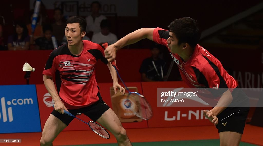 Lee Yong-Dae (R) and <a gi-track='captionPersonalityLinkClicked' href=/galleries/search?phrase=Yoo+Yeon-Seong&family=editorial&specificpeople=5805702 ng-click='$event.stopPropagation()'>Yoo Yeon-Seong</a> of South Korea hit a return against Mohammad Ahsan and Hendra Setiawan of Indonesia during their semi-final men's doubles match of the 2015 World Championships badminton tournament in Jakarta on August 15, 2015. AFP PHOTO / Bay ISMOYO