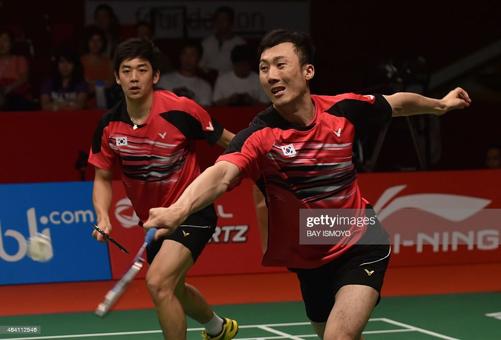 Lee Yong-Dae (L) and <a gi-track='captionPersonalityLinkClicked' href=/galleries/search?phrase=Yoo+Yeon-Seong&family=editorial&specificpeople=5805702 ng-click='$event.stopPropagation()'>Yoo Yeon-Seong</a> of South Korea hit a return against Mohammad Ahsan and Hendra Setiawan of Indonesia during their semi-final men's doubles match of the 2015 World Championships badminton tournament in Jakarta on August 15, 2015. AFP PHOTO / Bay ISMOYO
