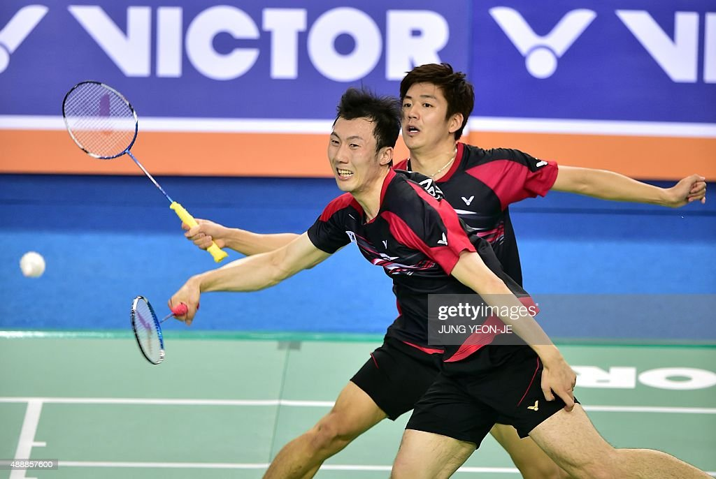 Lee Yong-Dae (back) and <a gi-track='captionPersonalityLinkClicked' href=/galleries/search?phrase=Yoo+Yeon-Seong&family=editorial&specificpeople=5805702 ng-click='$event.stopPropagation()'>Yoo Yeon-Seong</a> (front) of South Korea hit a return against Hiroyuki Endo and Kenichi Hayakawa of Japan during their men's doubles quarter-final match at the Korea Open Superseries badminton tournament in Seoul on September 18, 2015.