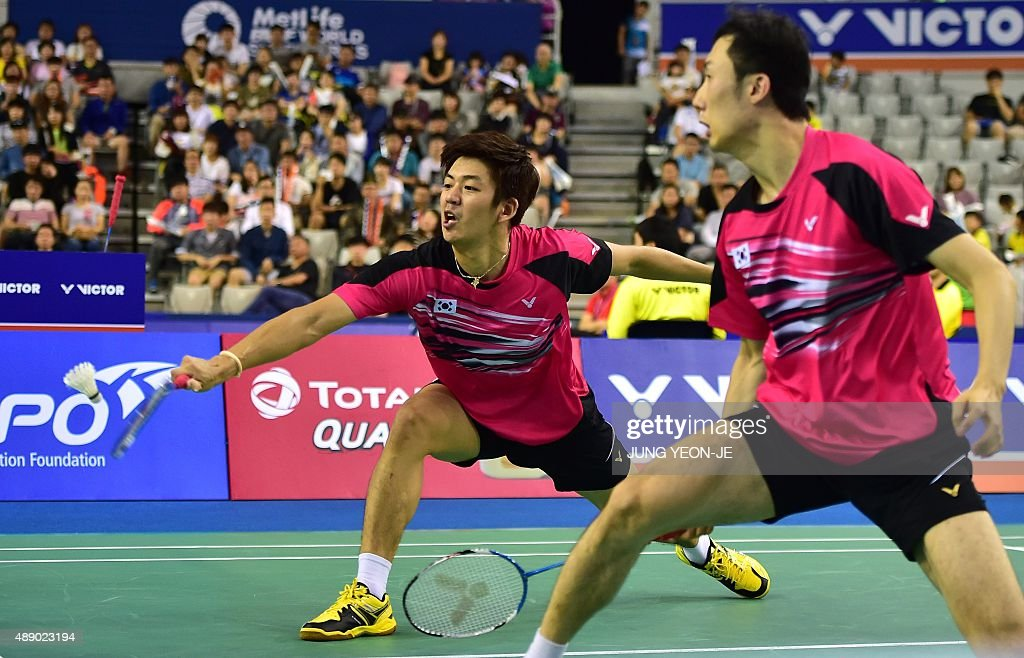 Lee Yong-Dae (L) and <a gi-track='captionPersonalityLinkClicked' href=/galleries/search?phrase=Yoo+Yeon-Seong&family=editorial&specificpeople=5805702 ng-click='$event.stopPropagation()'>Yoo Yeon-Seong</a> (R) of South Korea hit a return against Mathias Boe and Carsten Mogensen of Denmark during their men's doubles semi-final match at the Korea Open Superseries badminton tournament in Seoul on September 19, 2015. AFP PHOTO / JUNG YEON-JE
