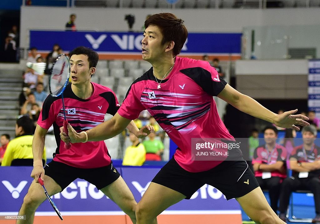 Lee Yong-Dae (R) and <a gi-track='captionPersonalityLinkClicked' href=/galleries/search?phrase=Yoo+Yeon-Seong&family=editorial&specificpeople=5805702 ng-click='$event.stopPropagation()'>Yoo Yeon-Seong</a> (L) of South Korea hit a return against Mathias Boe and Carsten Mogensen of Denmark during their men's doubles semi-final match at the Korea Open Superseries badminton tournament in Seoul on September 19, 2015. AFP PHOTO / JUNG YEON-JE