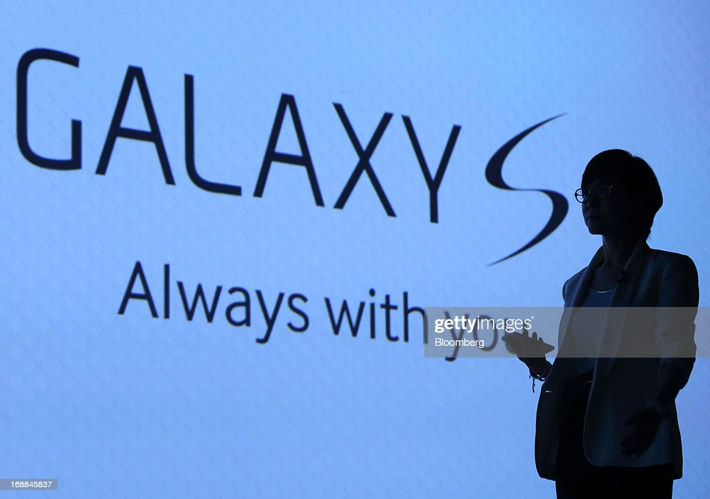 Lee Young Hee, executive vice president for the mobile business at Samsung Electronics Co., is silhouetted against a screen as she arrives for the Galaxy S4 World Tour 2013 Tokyo event in Tokyo, Japan, on Thursday, May 16, 2013. Samsung Electronics reported a record quarterly profit in April for the three months ended March 31. Photographer: Tomohiro Ohsumi/Bloomberg via Getty Images