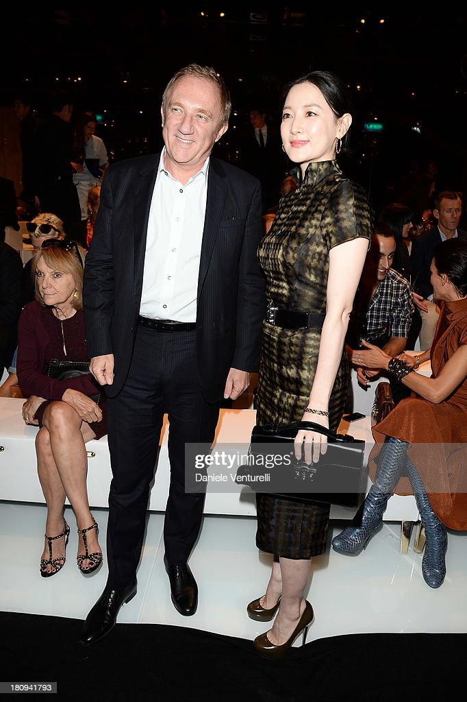 Lee YoungAe and Francois Henri Pinault attend the Gucci show as part of Milan Fashion Week Womenswear Spring/Summer 2014 on September 18 2013 in...