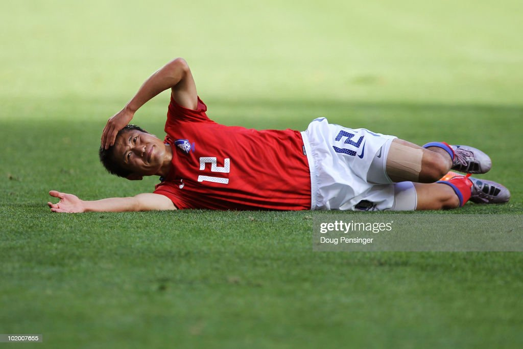 Lee YoungPyo of South Korea lies on the pitch injured during the 2010 FIFA World Cup South Africa Group B match between South Korea and Greece at...