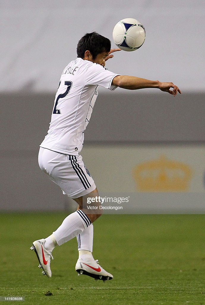 Lee YoungPyo of the Vancouver Whitecaps heads the ball during the MLS match against Chivas USA at The Home Depot Center on March 17 2012 in Carson...