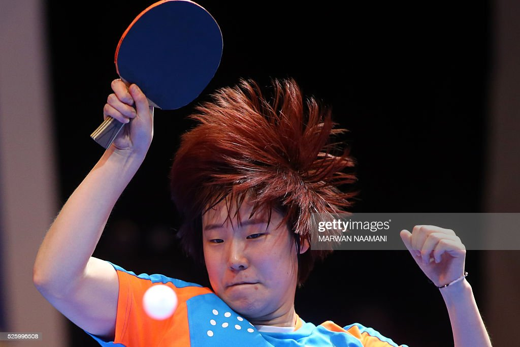 Lee Zion of Korea returns the ball to Batra Manika of India during their women's singles quarter final table tennis match in the ITTF Nakheel Table Tennis Asian Cup, in Dubai, on April 29, 2016. / AFP / MARWAN