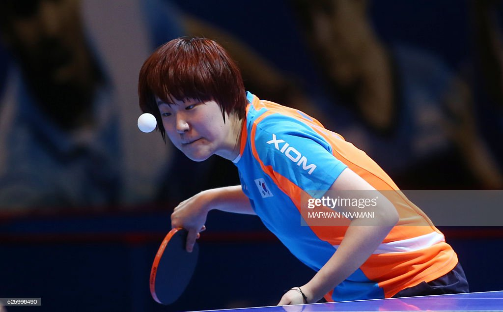 Lee Zion of Korea serves the ball to Batra Manika of India during their women's singles quarter final table tennis match in the ITTF Nakheel Table Tennis Asian Cup, in Dubai, on April 29, 2016. / AFP / MARWAN