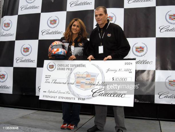 Leeann Tweeden is presented with a check for $10000 for te USO the charity she was racing for Leeann won the race for the second year in a row