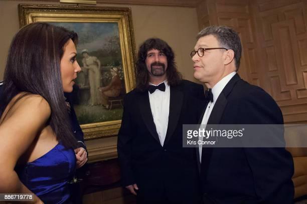 Leeann Tweeden Mike Foley and Al Franken talk before the 2009 USOMetro Awards Dinner at RitzCarltonPentagon City on March 25 2009 in Washington