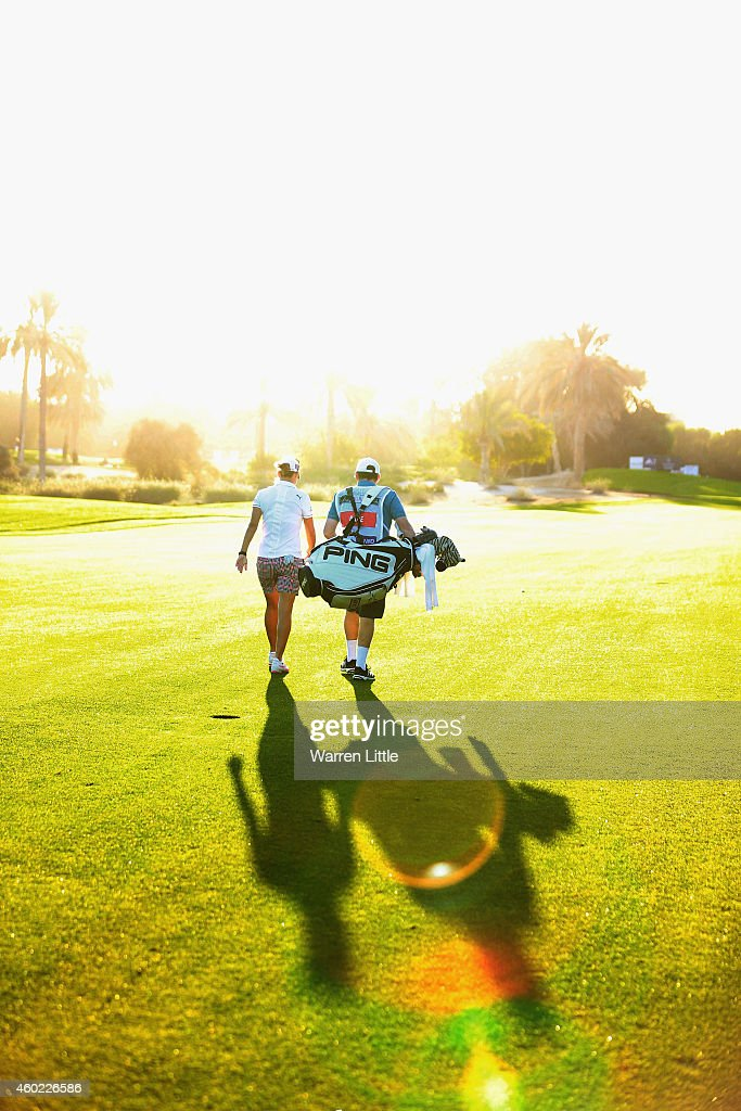 LeeAnne Pace of South Africa walks up the 10th fairway with her caddie during the first round of the Omega Dubai Ladies Maters on the Majlis Course...