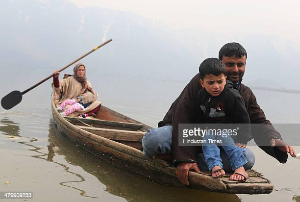 Leeches suck blood on the feet of a patient during a leech therapy session on a shallow side of a lake on March 21 2014 in Srinagar India Nauroz the...
