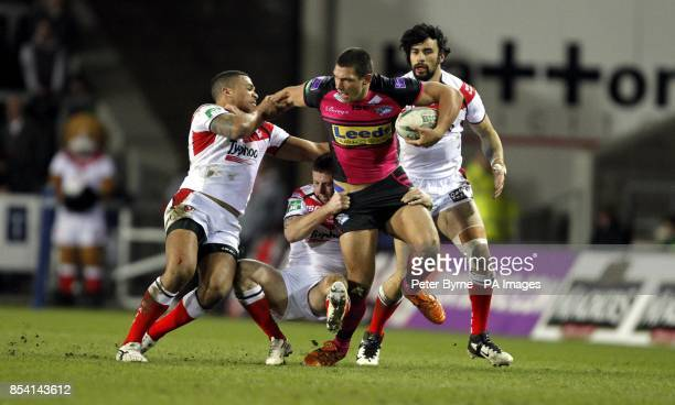 Leed Rhino's Ryan Hall is stopped by St Helen's Jordan Turner Gary Wheeler and Ade Gardner during the Super League match at Langtree Park St Helens