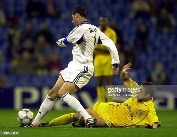 LEAGUE Leed United's Alan smith and Real Madrid's Fernando Hierro battle for the ball during a Champions League Group D match at the Bernabeu Stadium...
