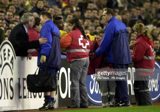LEAGUE Leed United's Lucas Radebe is taken off on a stretcher during today's Champions League Group D match at the Bernabeu Stadium Madrid