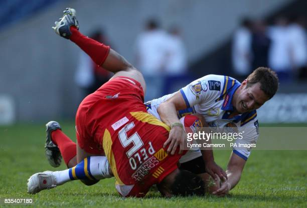 Leeds' Danny McGuire Catalan Dragons and Dimitri Pelo during the engage Super League Magic Weekend match at Murrayfield Stadium