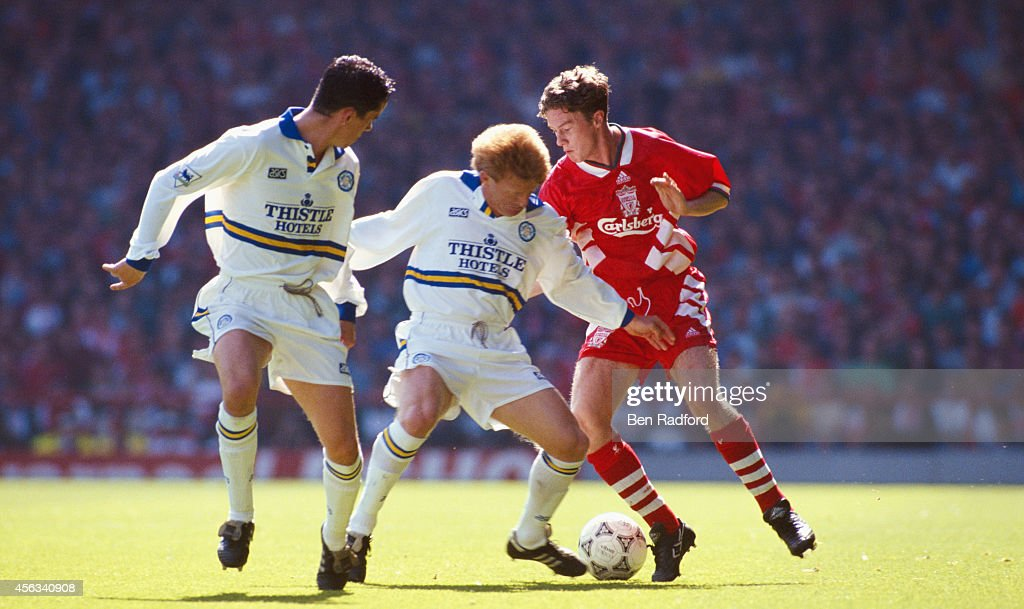 Leeds defenders Gary Kelly and Gordon Strachan attempt to halt Liverpool player Steve McManaman during a Premier League match between Liverpool and...