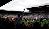 Leeds fans invade the pitch after winning promotion during the Coca Cola League One match between Leeds United and Bristol Rovers at Elland Road on...
