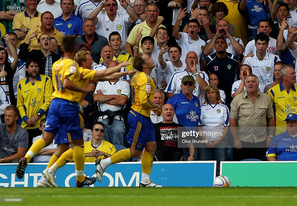 Leeds fans shout abuse at Chris Commons of Derby County as he celebrates with team mates after scoring his teams second goal from the penalty spot during the npower Championship match between Leeds United and Derby County at Elland Road on August 7, 2010 in Leeds, England.