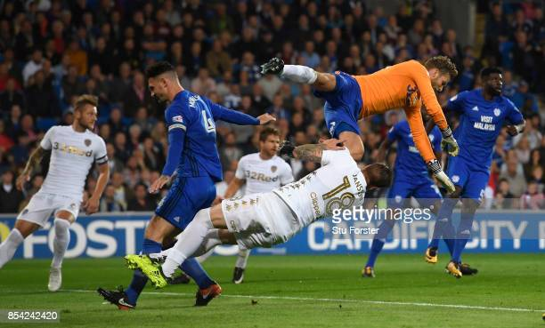 Leeds goalkeeper Felix Wiedwald catches his own player Pontus Jansson whilst clearing a corner during the Sky Bet Championship match between Cardiff...
