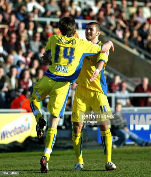 Leed's goalscorer Jonathan Howson celebrates his goal with team mate Bradley Johnson during the League One match at Sixfields Stadium Northampton