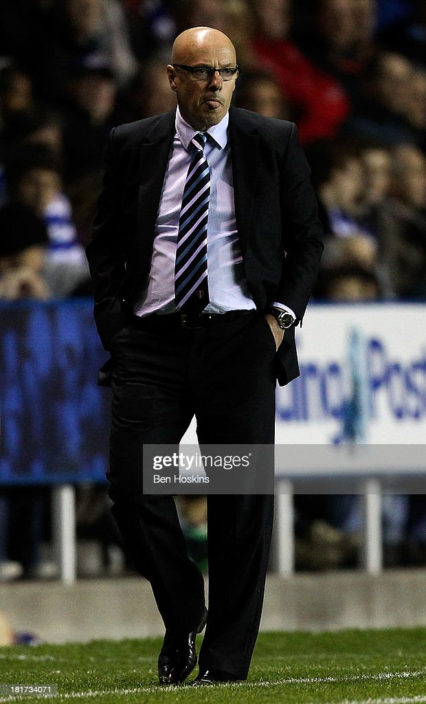 Leeds manager Brian McDermott looks on during the Sky Bet Championship match between Reading and Leeds United at Madejski Stadium on September 18, 2013 in Reading, England.
