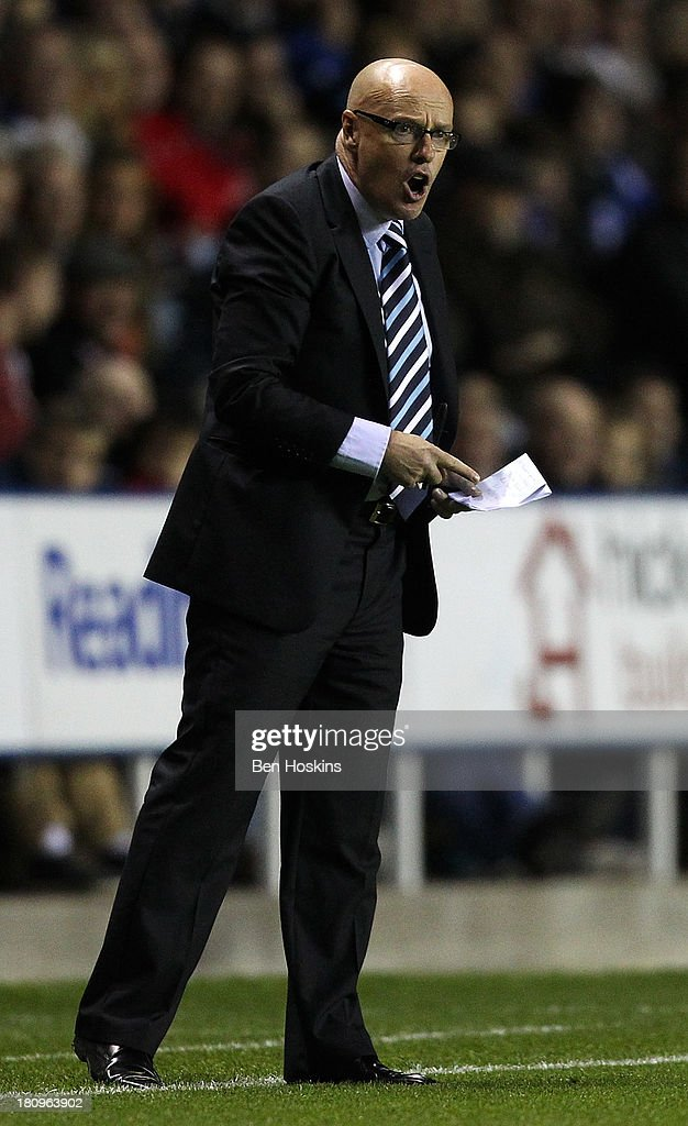 Leeds manager Brian McDermott shouts instructions during the Sky Bet Championship match between Reading and Leeds United at Madejski Stadium on September 18, 2013 in Reading, England.