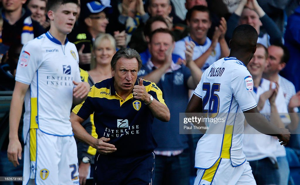 Leeds manager <a gi-track='captionPersonalityLinkClicked' href=/galleries/search?phrase=Neil+Warnock&family=editorial&specificpeople=644786 ng-click='$event.stopPropagation()'>Neil Warnock</a> (C) gestures towards his goal scorer Dominic Poleon during the npower Championship match between Leeds United and Nottingham Forest at Elland Road on September 22, 2012 in Leeds, England.