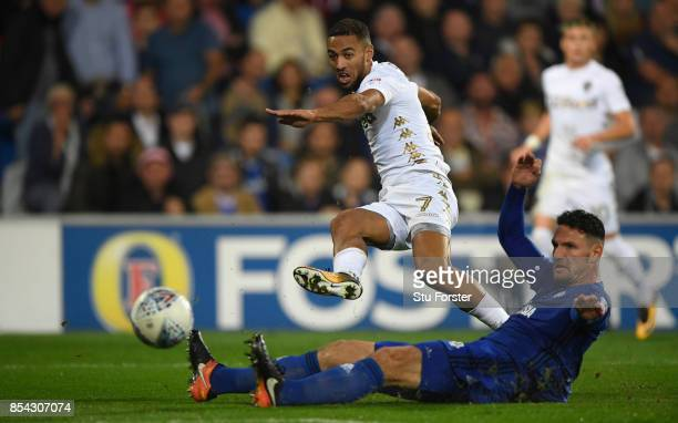 Leeds player Kemar Roofe gets a shot in at goal despite the challenge of Sean Morrison during the Sky Bet Championship match between Cardiff City and...